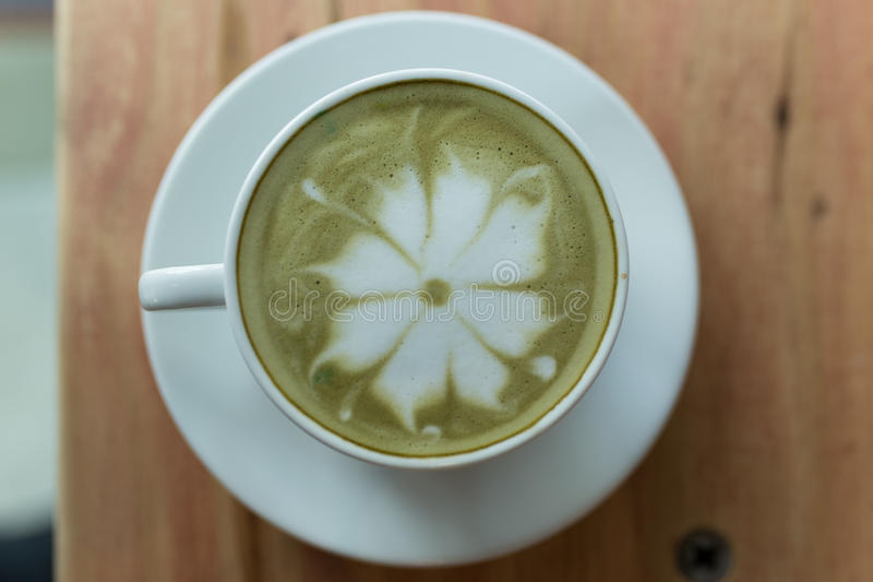 Top view matcha latte on a wooden background royalty free stock images
