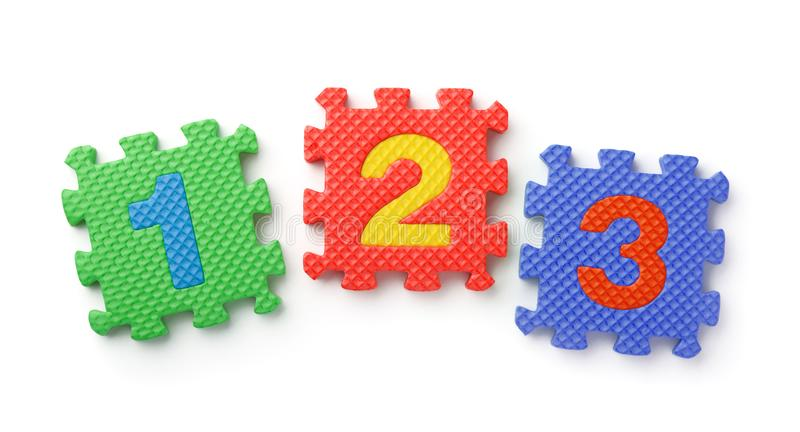 Top view of math numbers foam puzzle royalty free stock photos