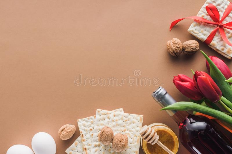 Passover Haggadah concept. Top view of matza, wine and honey on brown table, Passover Haggadah concept royalty free stock images