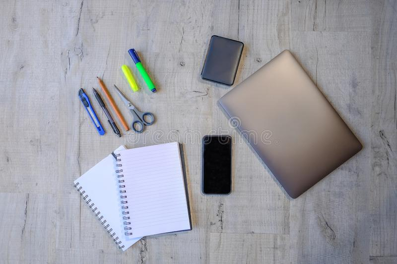 Top view of a media project. Top view of a project using laptop, hard drive, smartphone, notebooks and writing implements. Flat lay of educational and work stock photos