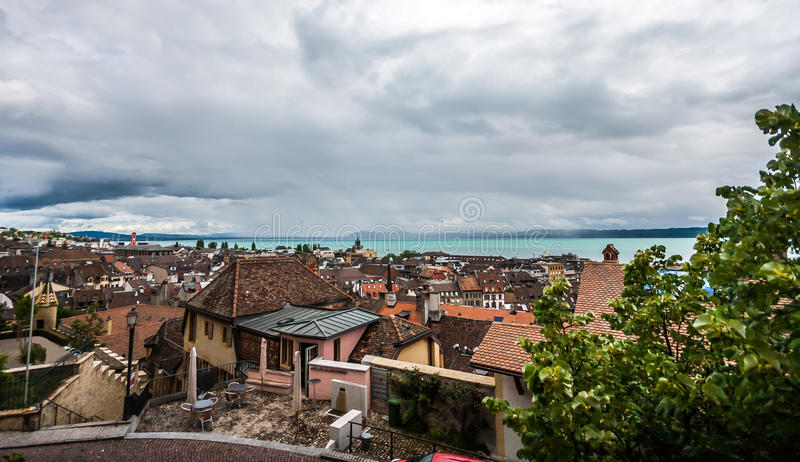 Top view of the medieval town Neuchatel with Lake Neuchatel and the Bernese Alps Chaumont seen on the horizon.  royalty free stock photography