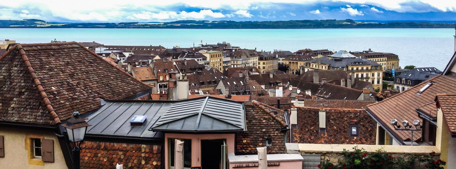 Top view of the medieval town Neuchatel with Lake Neuchatel and the Bernese Alps Chaumont seen on the horizon.  stock photography