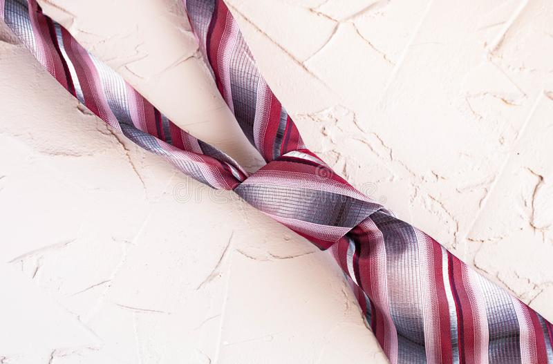 Top view of a men`s trendy striped tie on a beautiful background. Happy Fathers Day greeting card concept royalty free stock images