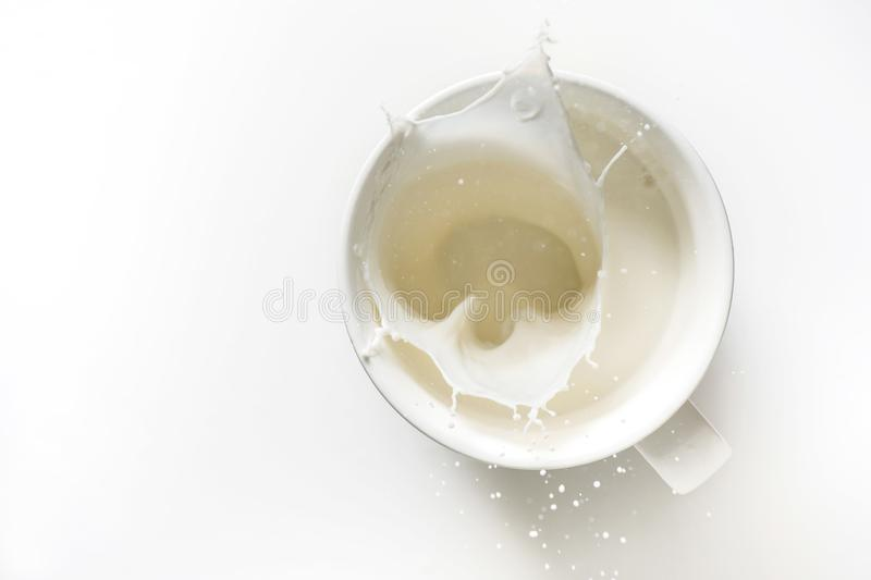 Top view of milk splash out of glass stock images