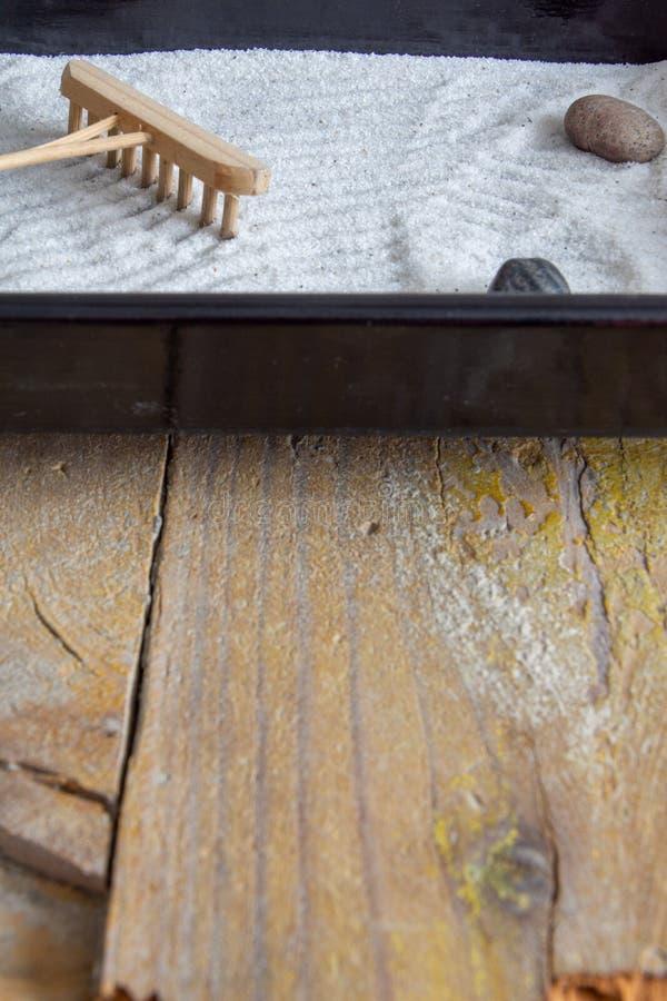 Top view of mini zen garden on wooden background stock images