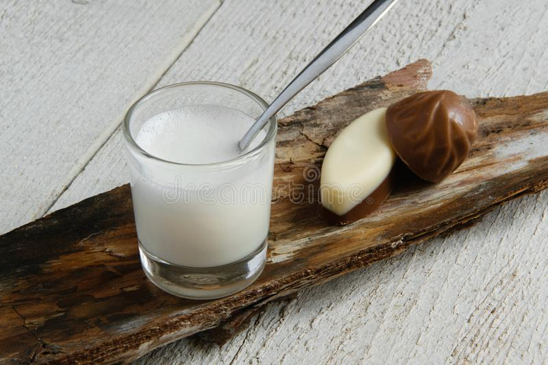 Top view of minimal milk drink style. Milk glass cup and chocolates on table, space for text stock images