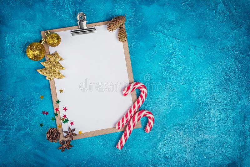 Top view of mock-up composition with blank white sheet of paper and Christmas decoration stock photography