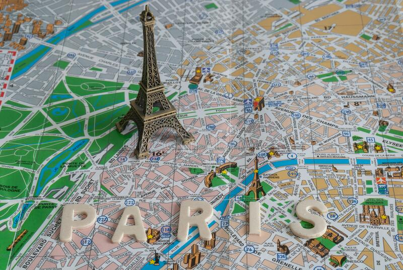 Top view of mockup of the Eiffel tower over Paris map royalty free stock image