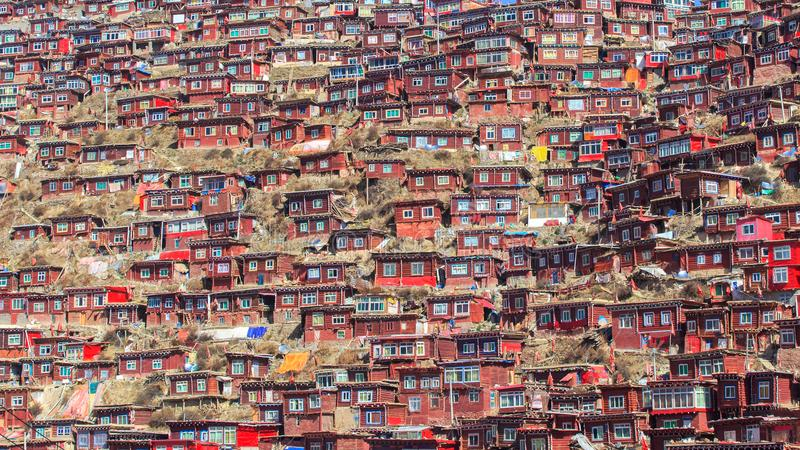 Top view monastery at Larung gar Buddhist Academy in sunshine day and background is blue sky royalty free stock photos