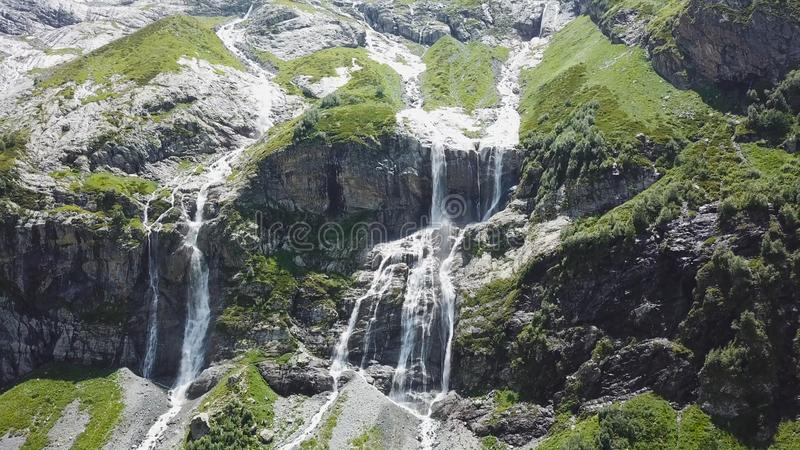 Top view of the mountain waterfall on a Sunny day. Amazing view of the waterfall from the top of the mountain stock photos