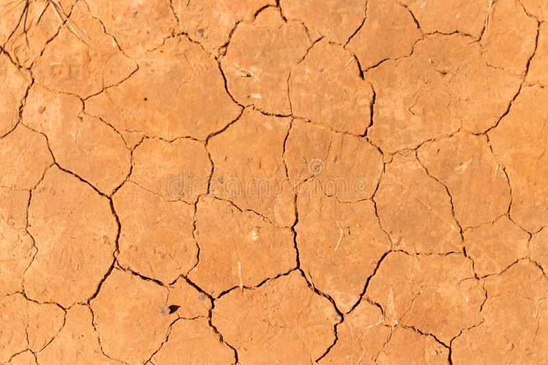 Top view on mud cracked dry ground abstract background stock images