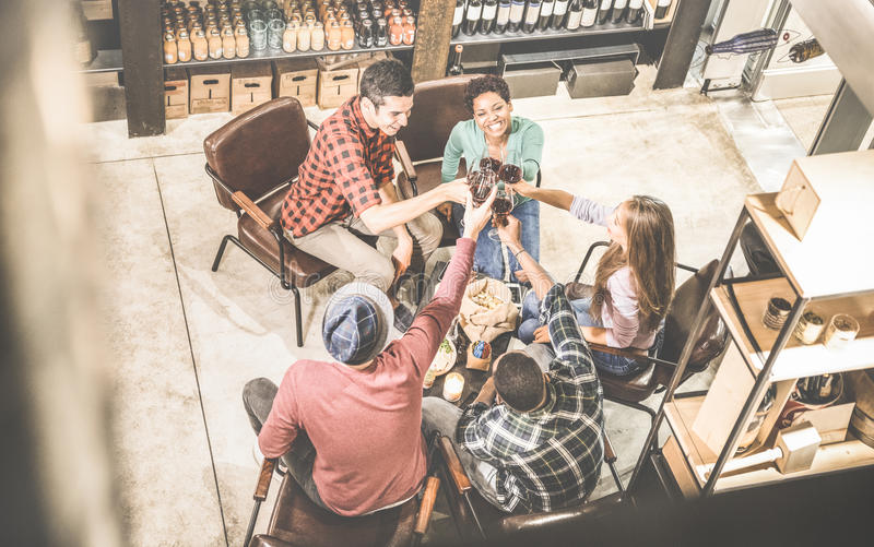 Top view of multi racial friends tasting red wine and having fun stock photo