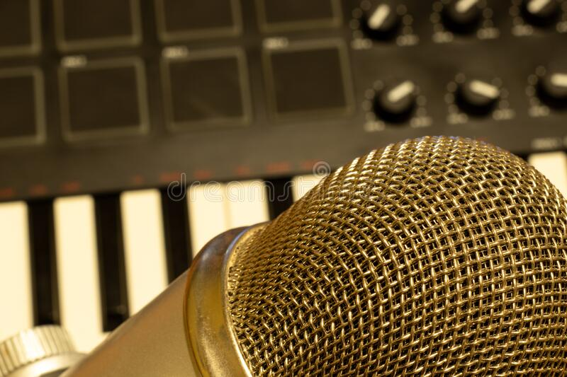 Top view of music producer workspace. Mic with keyboard close-up.  royalty free stock image