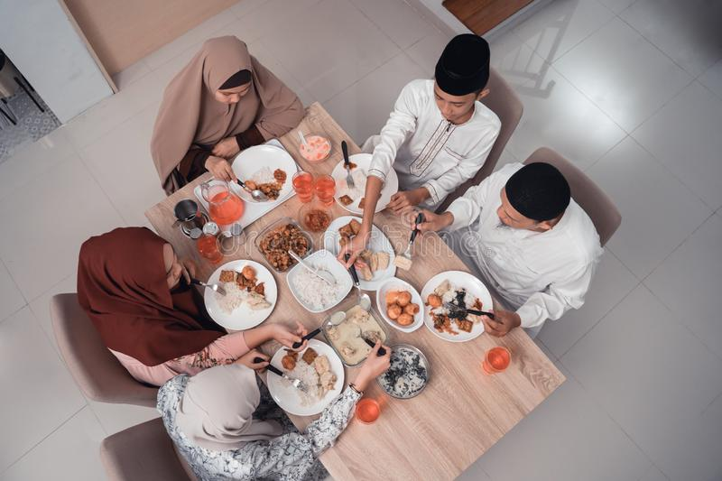 Top view muslim family enjoy the iftar meal dinner stock photos