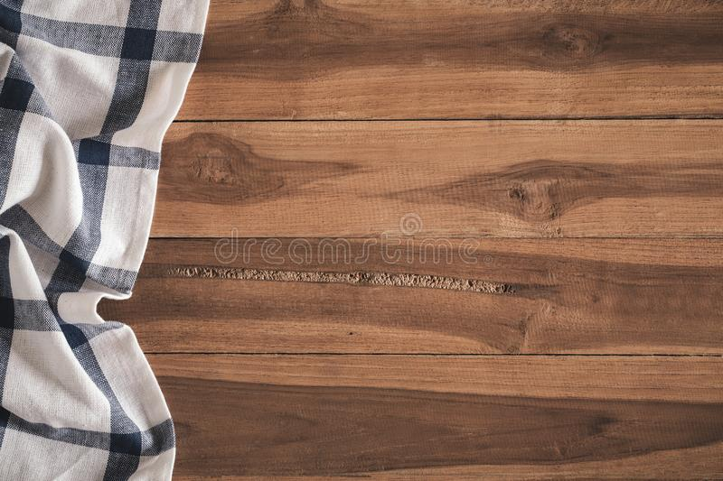 Top view of napkin on empty old wooden background royalty free stock photo