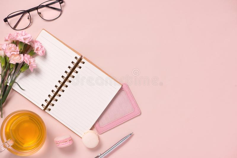 Top view note book anf flowers on the desktop. For wedding planner concept royalty free stock photo