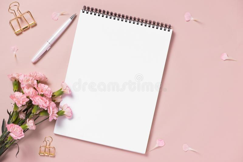 Top view note book anf flowers on the desktop. For wedding planner concept stock photo