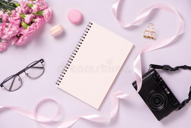 Top view note book anf flowers on the desktop. For wedding planner concept stock image