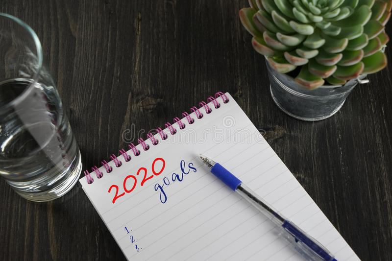 Top view of notebook with text 2020 goals and to do list royalty free stock images