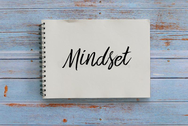 Top view of notebook written with Mindset on wooden background. Attitude, belief, positive, discipline, conscious, focus, business, diversity, mental stock photos