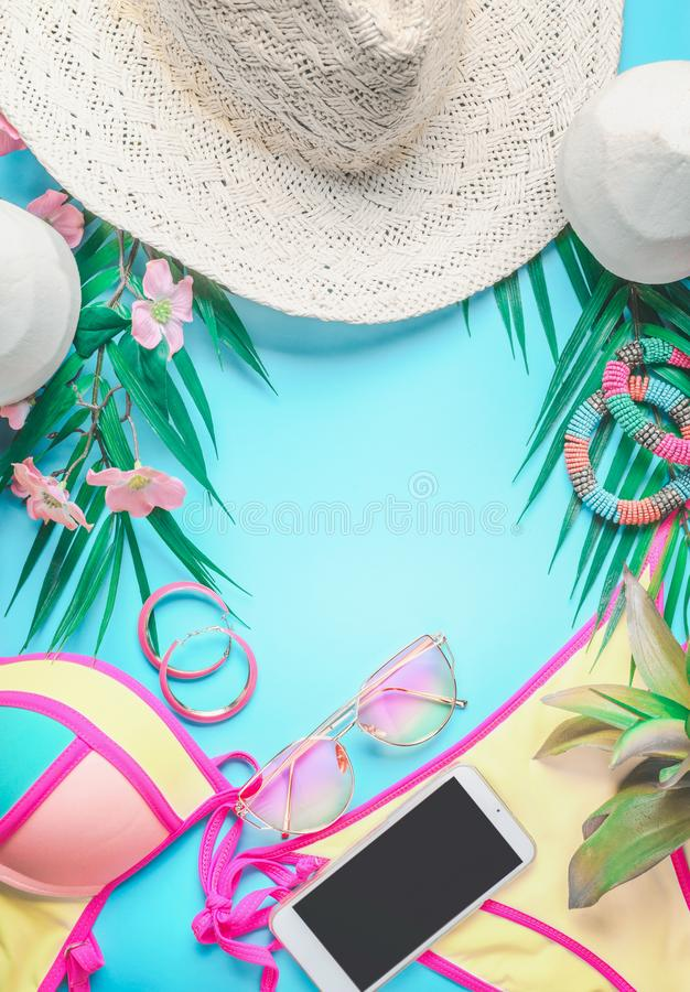 Free Top View Of Female Beach Accessories Background With Tropical Leaves And Flowers , Sunglasses And Straw Hat, Bikini And Royalty Free Stock Photo - 138038905
