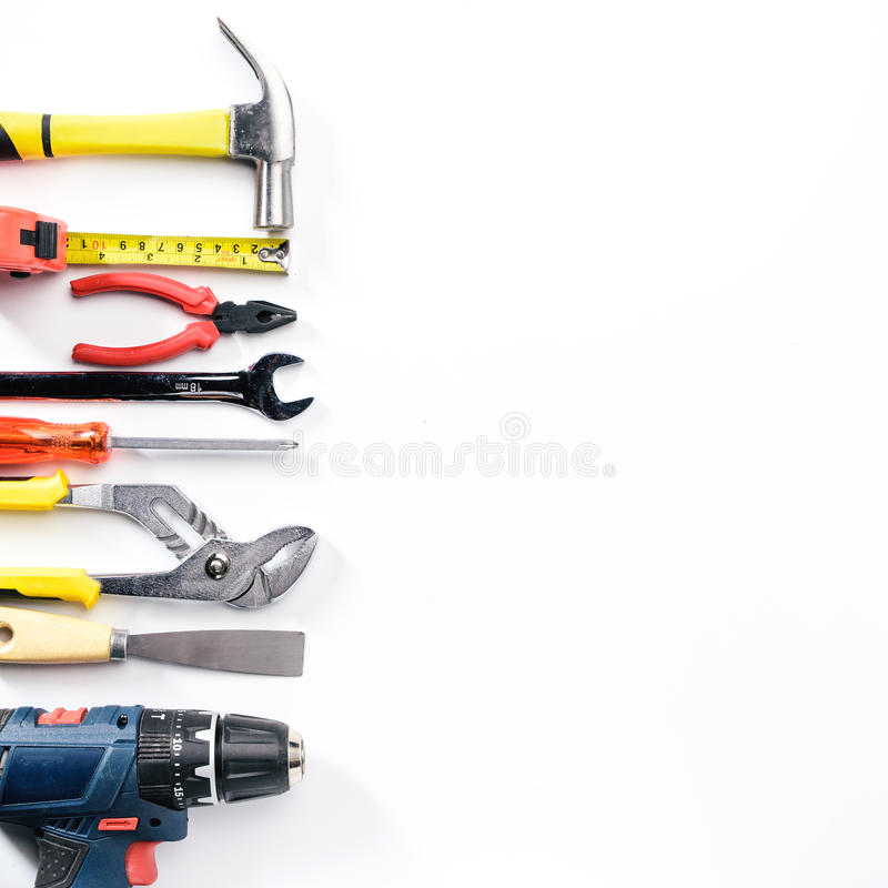Free Top View Of Working Tools,wrench,socket Wrench,hammer,screwdriver,plier,electric Drill,tape Measure,machinist Square On White Royalty Free Stock Images - 97109179