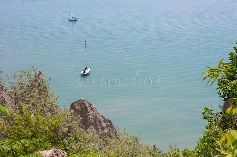 Scenic view of sail boats in a bay at Scarborough Bluffs in Toronto. Top view ofa scence of two sail boats in a bay at Scarborough Bluffs in Toronto royalty free stock images