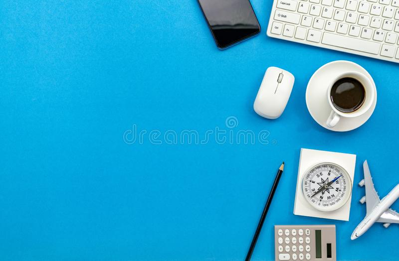 Top view of Office desk table of Business workplace and business objects on blue background copy space for your text stock images
