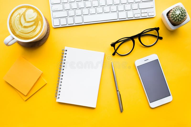 Top view of office desk table with modern accessories,supplies royalty free stock photo