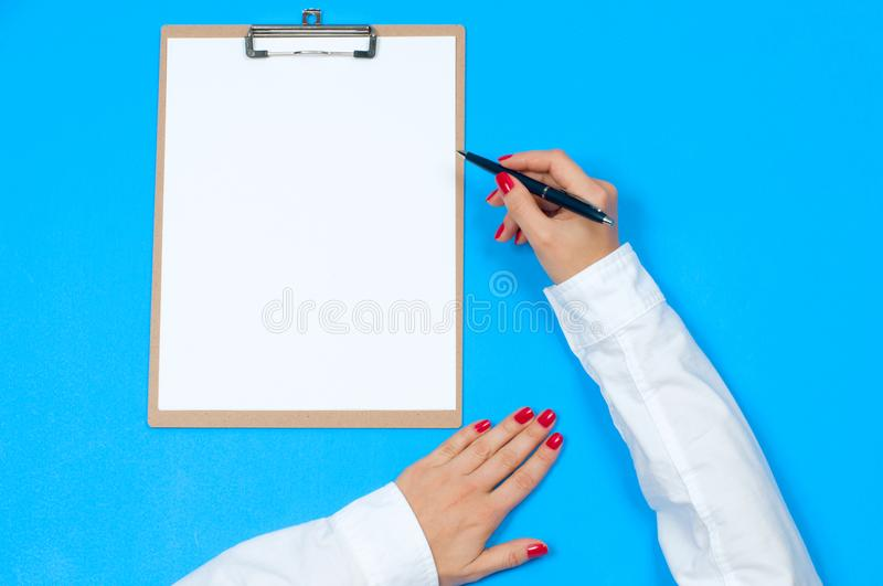 Top view office desk. Woman writing on document stock photography