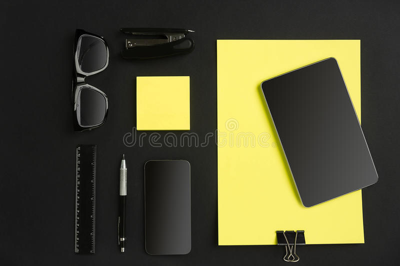 Top view of office supplies on blackboard background with copy space. Still life stock photo