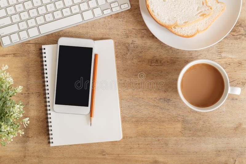 Top view  office table . On desk have notebook coffee cup laptop smartphone and pencil stock photos