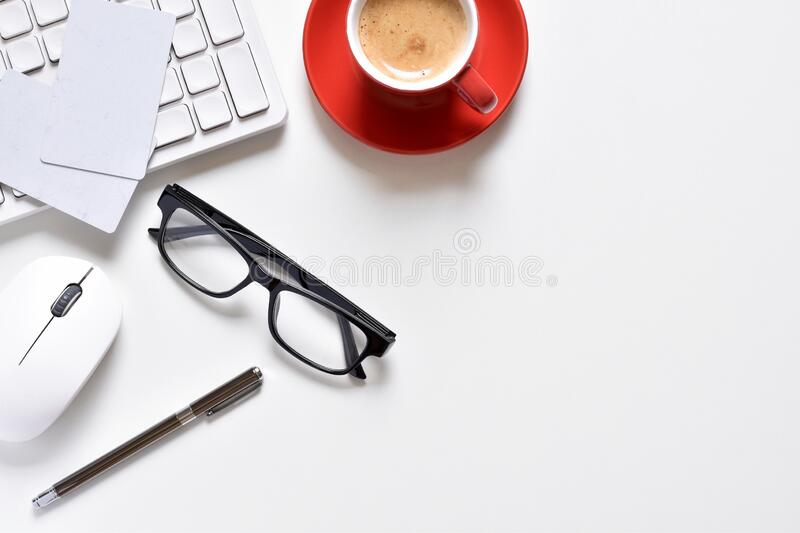 Top view office table, White desk with pen, keyboard, coffee cup, mouse, credit card and eyeglasses is elements. stock photography
