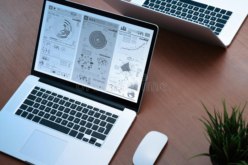 Top view of Office workplace with two laptops and mouse on wood royalty free stock photography