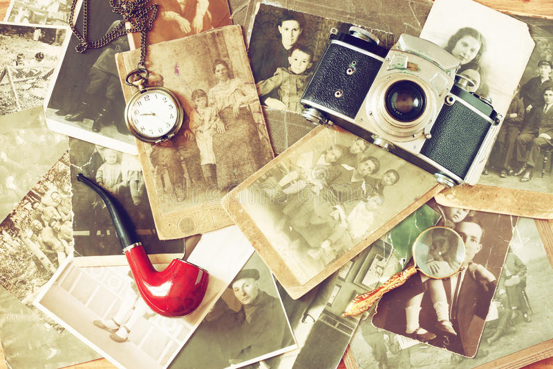 Top view of old camera, antique photographs and old pocket clock stock photography