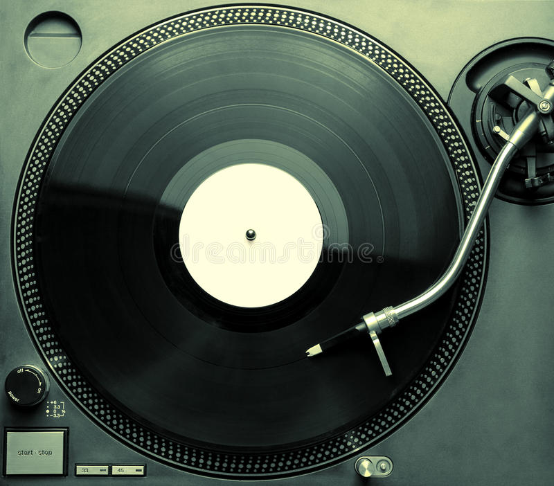 Top view of old fashioned turntable playing a track stock photo