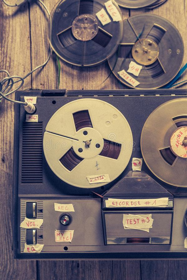 Old reel audio recorder and roll tapes. Top view of old reel audio recorder and roll tapes stock image