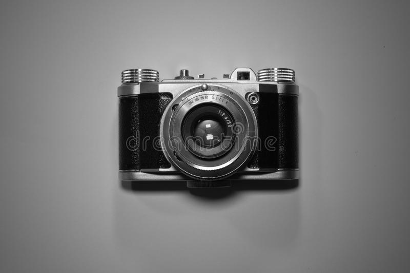 Download top view of old retro vintage camera isolated and highlighted in black and white stock