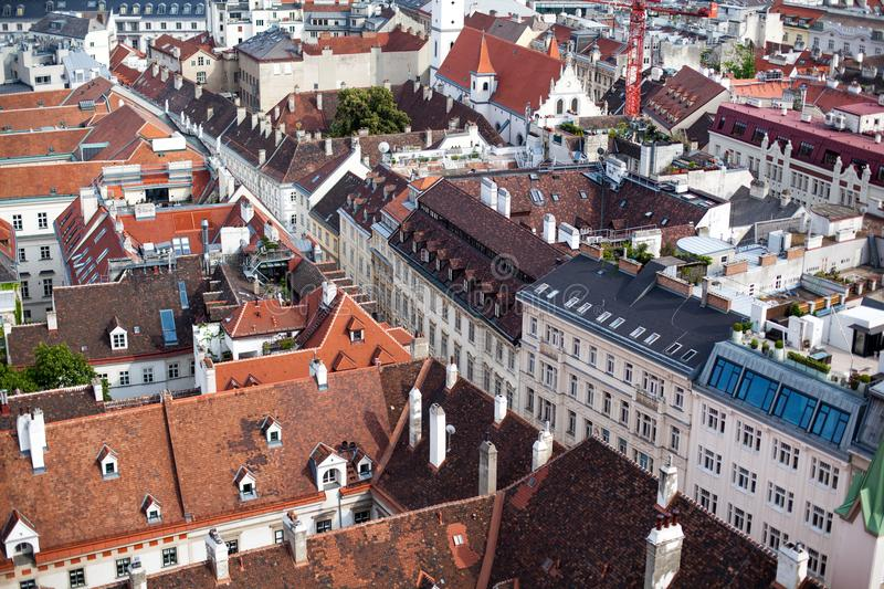 Top View of old town from St. Stephen`s Cathedral, Vienna, Austria. tiled roofs of european city royalty free stock image
