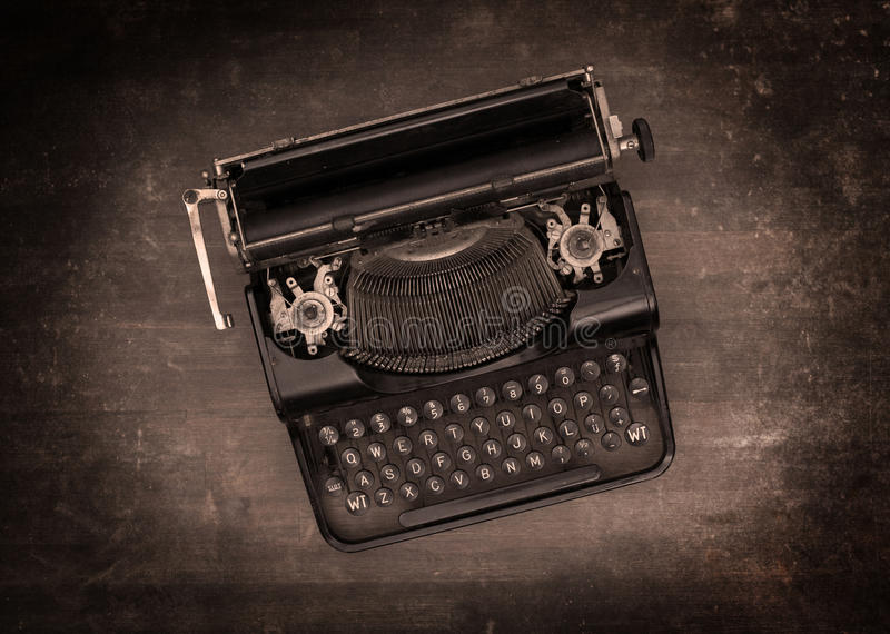 Top view of an old typewriter. On a wooden table - warm effect stock photography