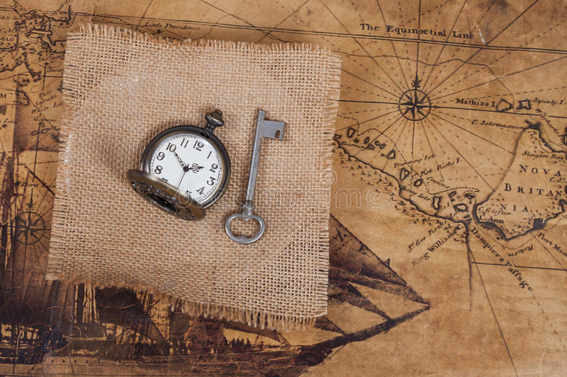Top view of old vintage pocket watch on burlap. Canvas stock photos