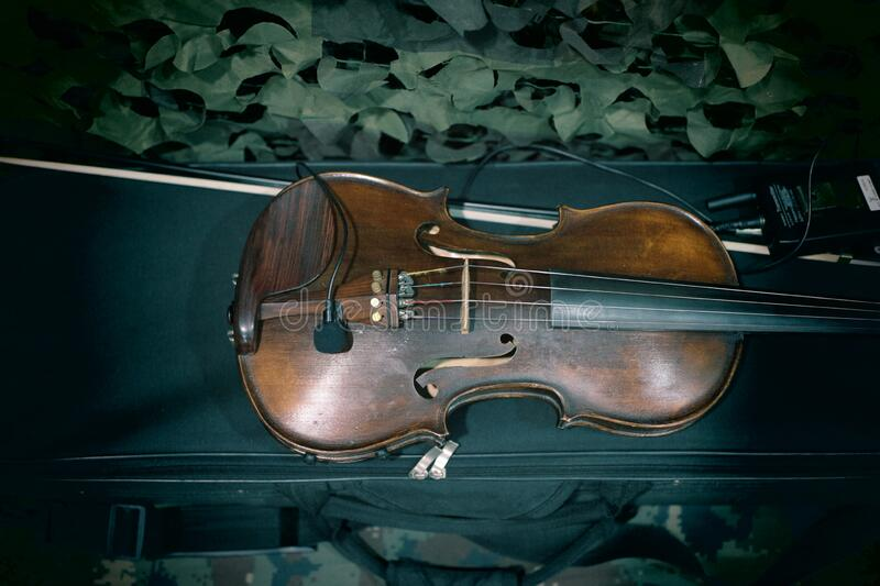 Top view, old wooden violin with wood bows  Selectable black background stock image