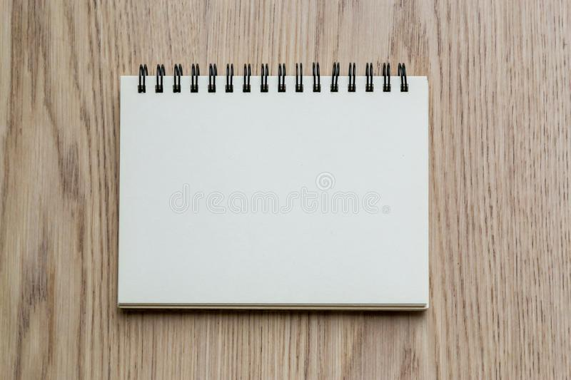 Top view open blank notebook on a light wooden table, copy space royalty free stock photography