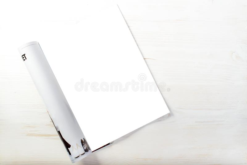Top view of open magazine with blank white pages on light wooden. Background, mock up for text. Ready for your new design and pattern royalty free stock images