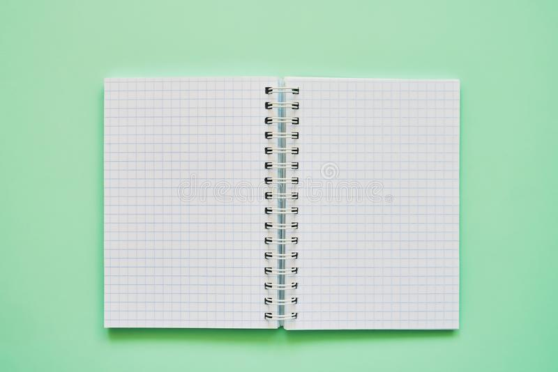 Top view of open notebook with blank pages, school notebook on a green background, spiral notepad stock images