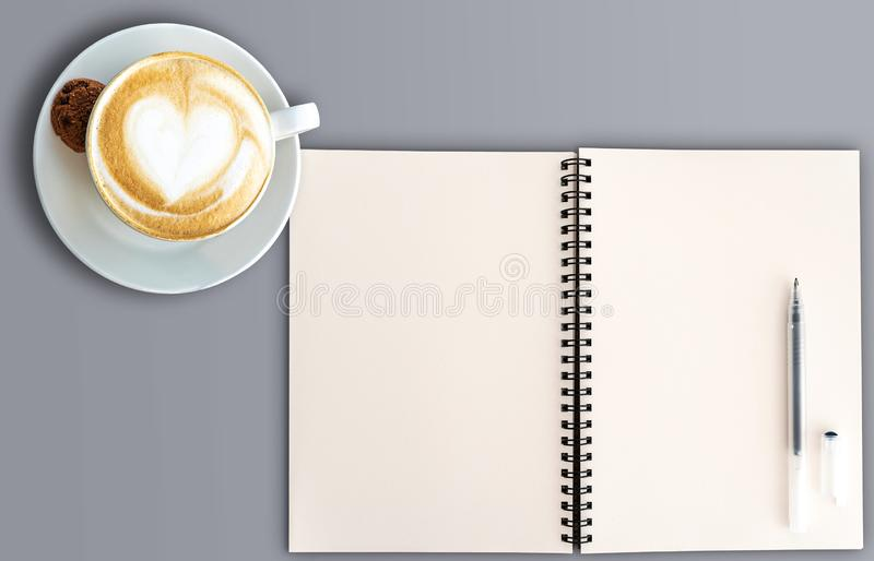 Top view of open spral note pad and cup of cappuccino royalty free stock photos