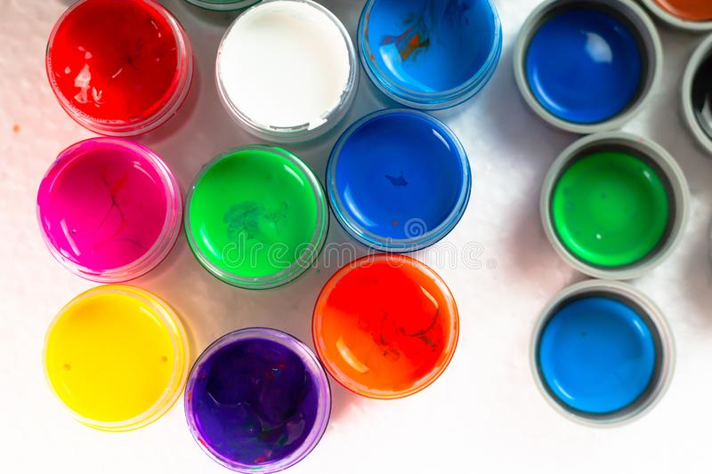 Opened bottles poster color. Top view of opened bottles poster color for paint on white background. Select focus shallow depth of field stock images