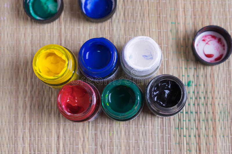 Top view of opened bottles of poster paint stock image
