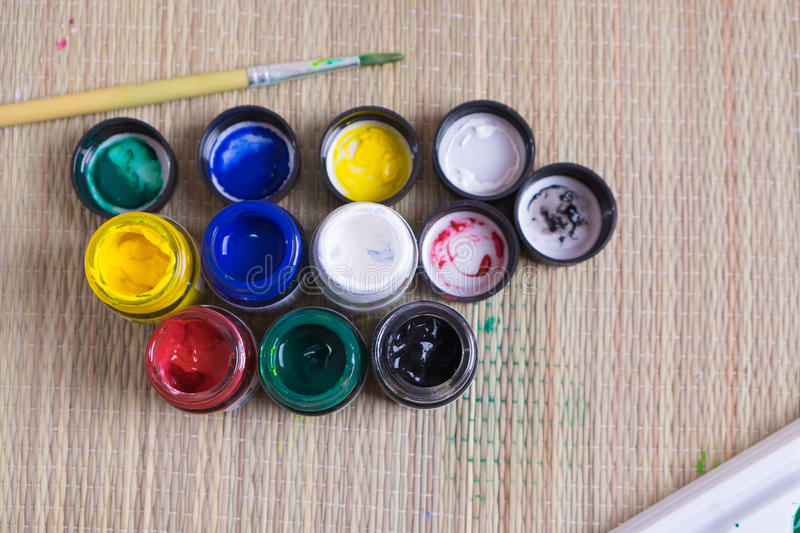 Top view of opened bottles of poster paint stock photo