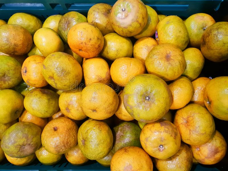 Top view of orange fruit as a background on market stand in Thailand. royalty free stock photography